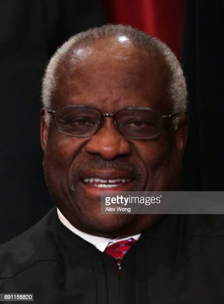 Supreme Court Associate Justice Clarence Thomas poses for a portrait in the East Conference Room of the Supreme Court June 1, 2017 in Washington, DC....