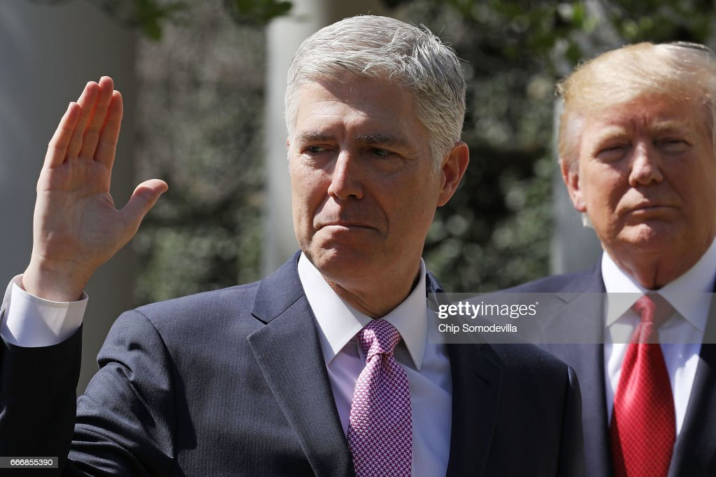 U.S. Supreme Court Associate Justice Judge Neil Gorsuch takes the judicial oath as President Donald Trump looks on during a ceremony in the Rose Garden at the White House April 10, 2017 in Washington, DC. Earlier in the day Gorsuch, 49, was sworn in as the 113th Associate Justice in a private ceremony at the Supreme Court.
