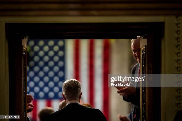 Supreme Court Associate Justice Neil Gorsuch enters the House of Representatives Chamber for President Donald Trump's first State of the Union...