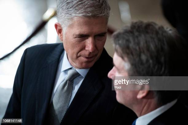 S Supreme Court Associate Justice Neil M Gorsuch and Associate Justice Brett M Kavanaugh wait for the arrival of former US President George HW Bush...