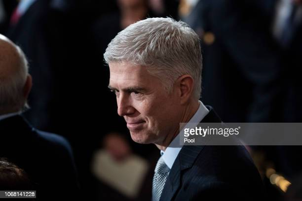 S Supreme Court Associate Justice Neil M Gorsuch waits for the arrival of former US President George HW Bush at the US Capitol Rotunda on December 03...