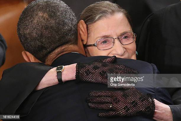 Supreme Court Associate Justice Ruth Bader Ginsburg hugs US President Barack Obama before Obama delivered his State of the Union speech before a...