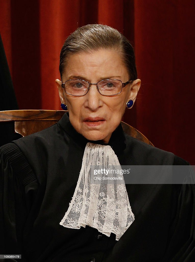 U.S. Supreme Court Associate Justice Ruth Bader Ginsburg poses for photographs in the East Conference Room at the Supreme Court building October 8, 2010 in Washington, DC. This is the first time in history that three women are simultaneously serving on the court.
