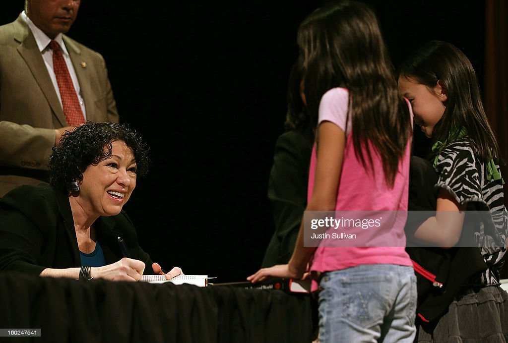 US Supreme Court Associate Justice Sonia Sotomayor signs copies of her book during a Commonwealth Club of California event at Herbst Theatre on January 28, 2013 in San Francisco, California. Sotomayor spoke in conversation with Stanford law school dean Mary Elizabeth Magill at the Commonwealth Club as she promotes her new book 'My Beloved World'