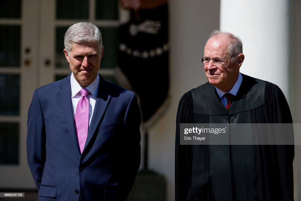 U.S. Supreme Court Associate Justices Anthony Kennedy and Neil Gorsuch are seen during a ceremony in the Rose Garden at the White House April 10, 2017 in Washington, DC. Earlier in the day Gorsuch, 49, was sworn in as the 113th Associate Justice in a private ceremony at the Supreme Court.