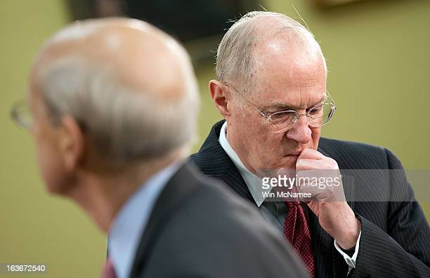 Supreme Court Associate Justices Anthony Kennedy and Stephen Breyer await the start of a hearing on Capitol Hill March 14 2013 in Washington DC...