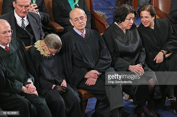Supreme Court associate justices Anthony Kennendy Ruth Bader Ginsburg John Paul Stevens Sonia Sotomayor and Elena Kagan attend US President Barack...