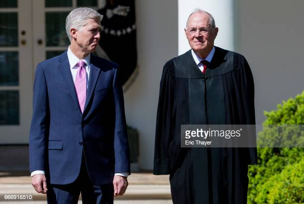 S Supreme Court Associate Justices Neil Gorsuch and Anthony Kennedy are seen during a ceremony in the Rose Garden at the White House April 10 2017 in...