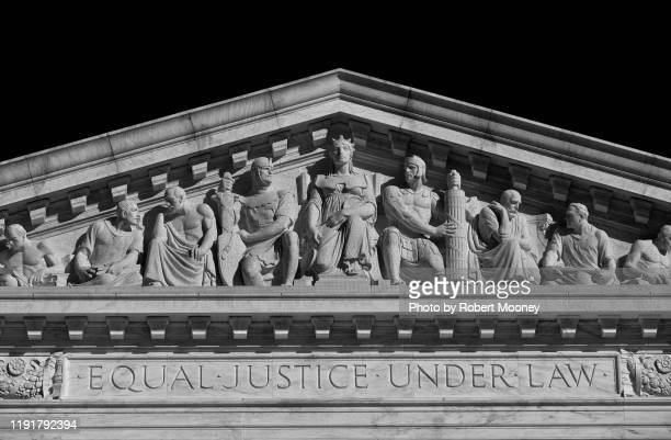 "u.s. supreme court building: inscription ""equal justice under law"" and sculpture above main west entrance - capitol hill stock pictures, royalty-free photos & images"