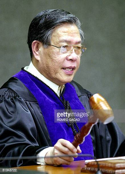 Supreme Court Chief Justice Hilario Davide bangs the gavel during the impeachment trial of President Joseph Estrada 03 January 2001 January Davide...