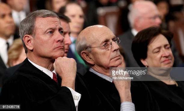 Supreme Court Chief Justice John G. Roberts , Associate Justice Stephen G. Breyer, and Associate Justice Elena Kagan listen to President Trump's...