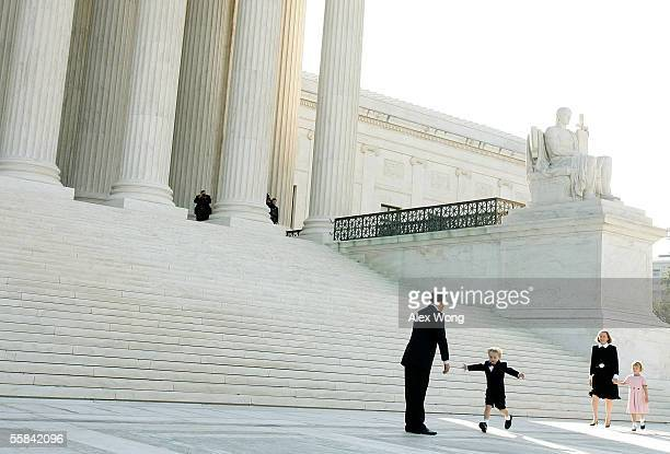 Supreme Court Chief Justice John G. Roberts leans forward as his son, Jack , runs toward him with open arms and wife, Jane, and daughter, Josie,...