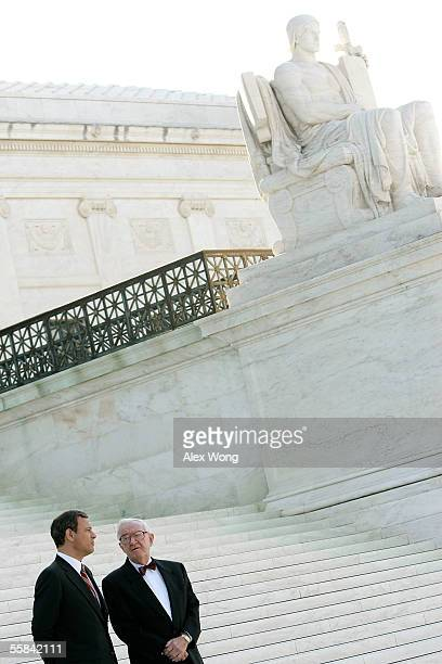 Supreme Court Chief Justice John G. Roberts talks to Justice John Paul Stevens after an investiture ceremony at the Supreme Court October 3, 2005 in...