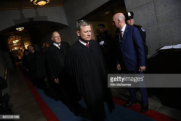 Supreme Court Chief Justice John Roberts and Anthony Kennedy arrive on the West Front of the US Capitol on January 20 2017 in Washington DC In...