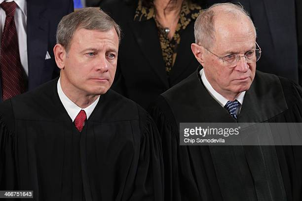Supreme Court Chief Justice John Roberts and Associate Justice Anthony Kennedy listen to President Barack Obama deliver the State of the Union...