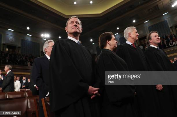Supreme Court Chief Justice John Roberts and Associate Justices Elena Kagan, Neil Gorsuch and Brett Kavanaugh await the arrival to hear President...