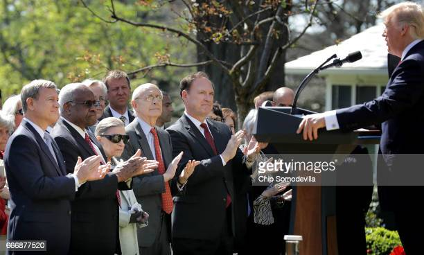 US Supreme Court Chief Justice John Roberts and associate justices Clarence Thomas Ruth Bader Ginsburg Stephen Breyer and Samuel Alito applaud for US...