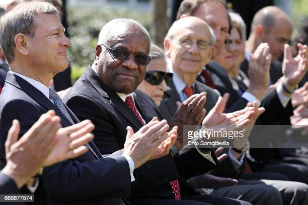 Supreme Court Chief Justice John Roberts and associate justices Clarence Thomas, Ruth Bader Ginsburg, Stephen Breyer and Samuel Alito attend the...