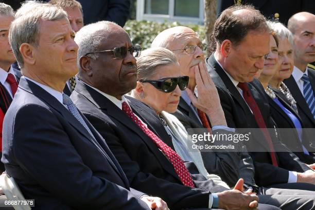 US Supreme Court Chief Justice John Roberts and associate justices Clarence Thomas Ruth Bader Ginsburg Stephen Breyer Samuel Alito and Elena Kagan...