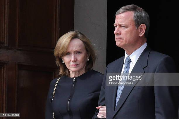 Supreme Court Chief Justice John Roberts and his wife Jane Roberts leave the Basilica of the National Shrine of the Immaculate Conception following...