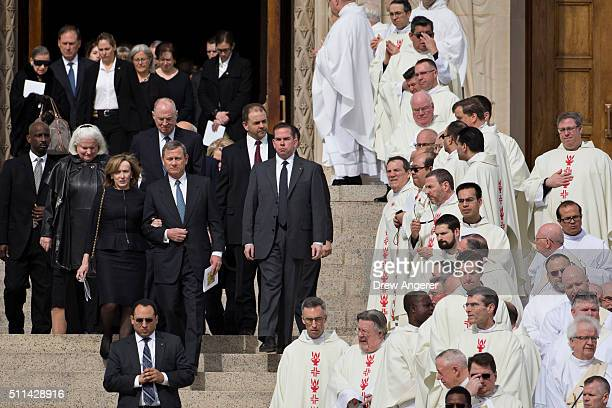 Supreme Court Chief Justice John Roberts and his wife Jane Sullivan Roberts lead a procession of current and former Supreme Court justices down the...