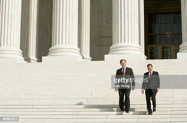 S Supreme Court Chief Justice John Roberts and Justice Samuel Alito walk down the steps of the court house after an investiture ceremony for Alito...