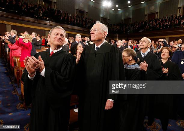 S Supreme Court Chief Justice John Roberts applauds with fellow Justices Anthony Kennedy Ruth Bader Ginsburg Stephen Breyer and Elena Kagan prior to...