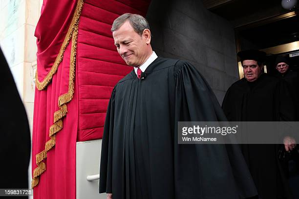 Supreme Court Chief Justice John Roberts arrives during the presidential inauguration on the West Front of the U.S. Capitol January 21, 2013 in...