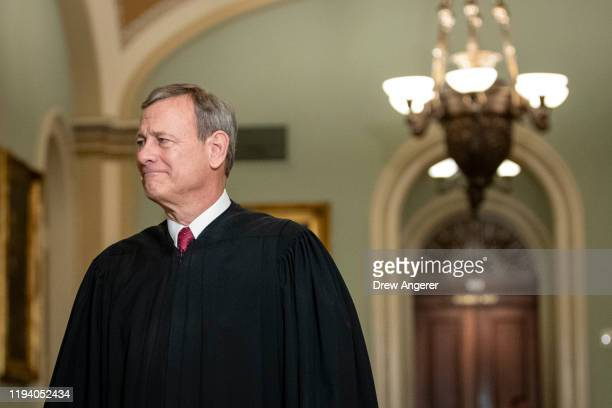 Supreme Court Chief Justice John Roberts arrives to the Senate chamber for impeachment proceedings at the US Capitol on January 16 2020 in Washington...