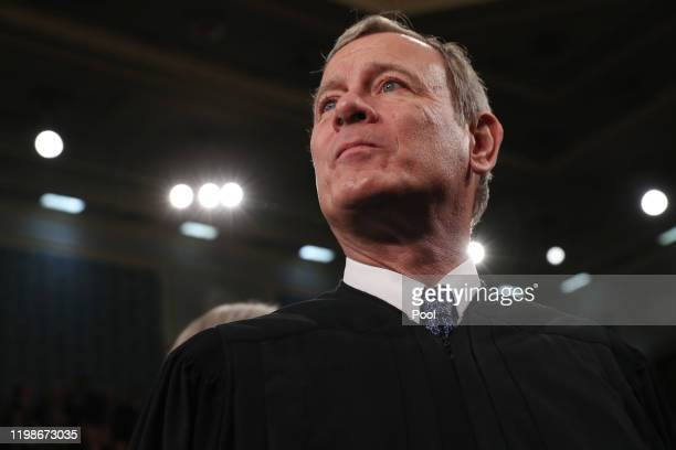 Supreme Court Chief Justice John Roberts awaits the arrival to hear President Donald Trump deliver the State of the Union address in the House...