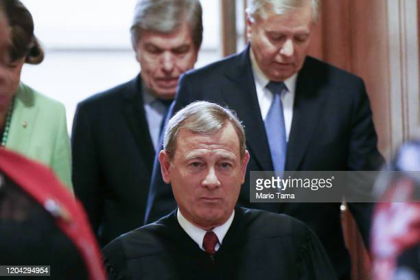 Supreme Court Chief Justice John Roberts departs the Senate chamber along with Sen. Lindsey Graham and Sen. Roy Blunt after the Senate impeachment...