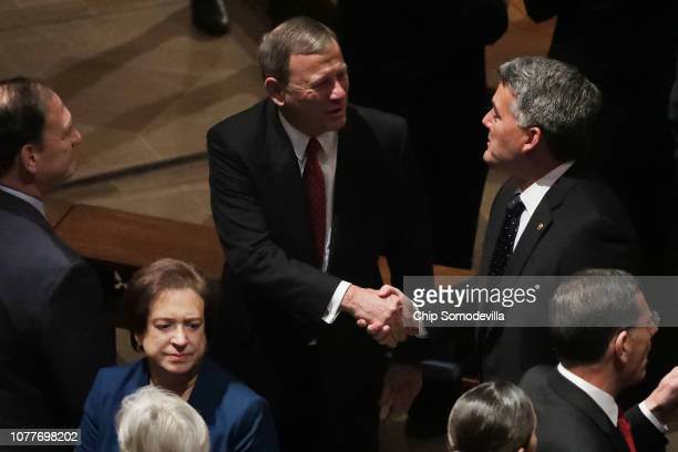 Supreme Court Chief Justice John Roberts greets Sen Cory Gardner during the state funeral for former President George HW Bush at the National...