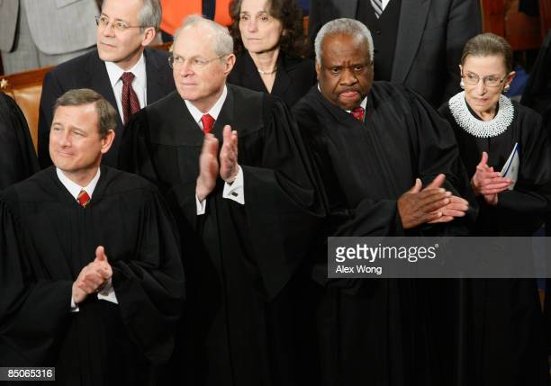 Supreme Court Chief Justice John Roberts joins Justice Anthony Kennedy, Justice Clarence Thomas, and Justice Ruth Bader Ginsburg in applauding the...