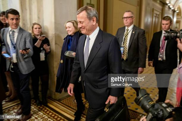 Supreme Court Chief Justice John Roberts leaves the U.S. Capitol building after the Senate impeachment trial of President Donald Trump was adjourned...