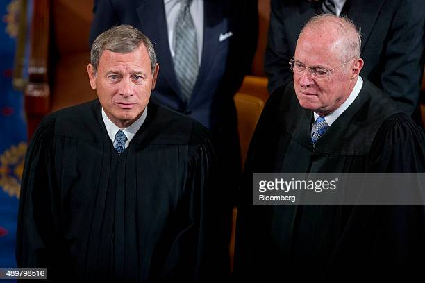 Supreme Court Chief Justice John Roberts left and Anthony Kennedy associate justice of the Supreme Court talk before listening to Pope Francis not...