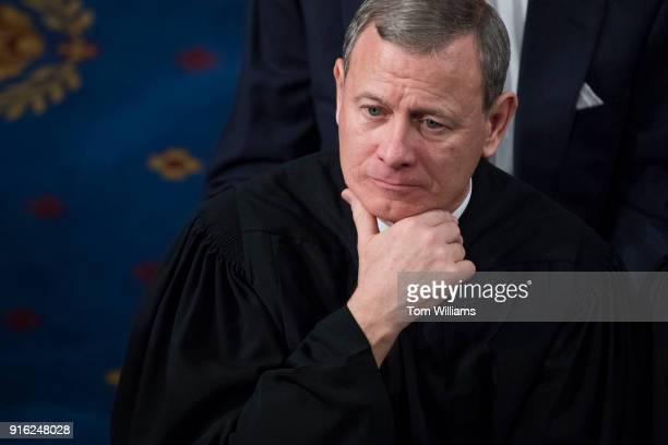 Supreme Court Chief Justice John Roberts listens to President Donald Trump's State of the Union address to a joint session of Congress on January 30...
