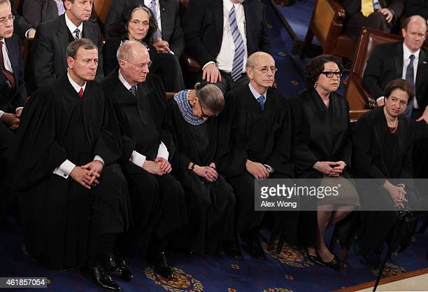 US Supreme Court Chief Justice John Roberts with Justices Anthony Kennedy Ruth Bader Ginsburg Stephen Breyer Sonia Sotomayor and Elena Kagan listen...