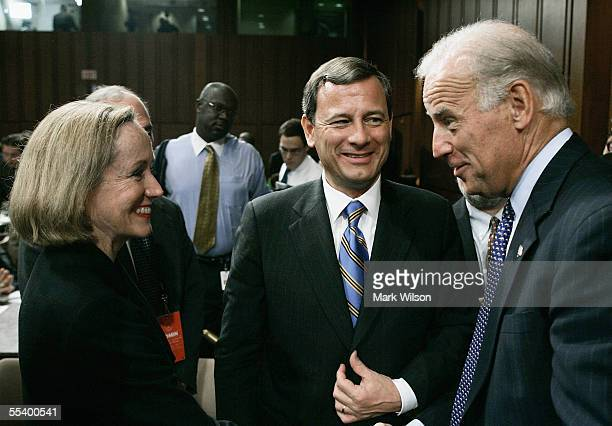 S Supreme Court Chief Justice nominee John Roberts and his wife Jane Sullivan Roberts greet US Sen Joe Biden during a break in the third day of...