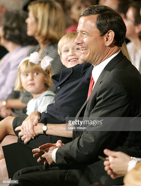 S Supreme Court Chief Justice nominee John Roberts arrives for his first day of confirmation hearings with his son Jack 4yearsold and daughter Josie...