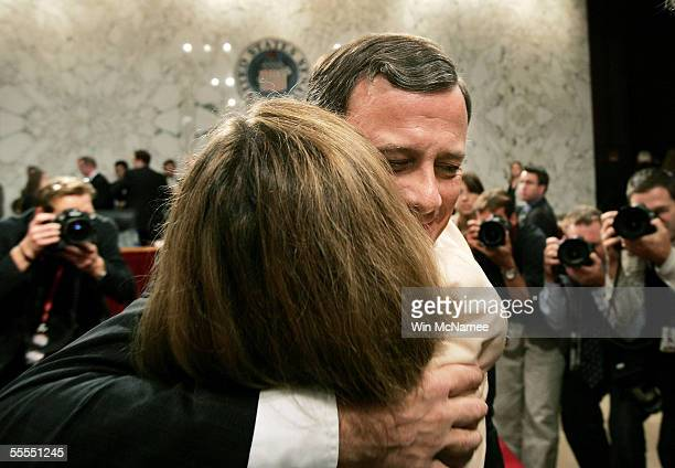 S Supreme Court Chief Justice Nominee John Roberts embraces his wife Jane Sullivan Roberts at the end of the judge's testimony during confirmaton...