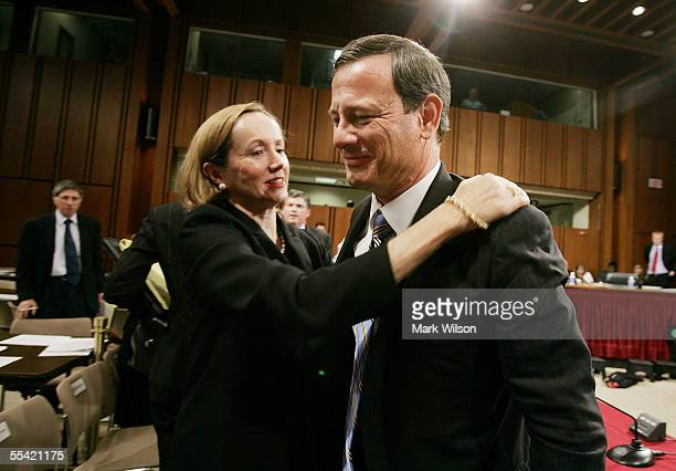 Supreme Court Chief Justice Nominee John Roberts gets a hug from his wife Jane Sullivan Roberts after a third day of confirmation hearings September...