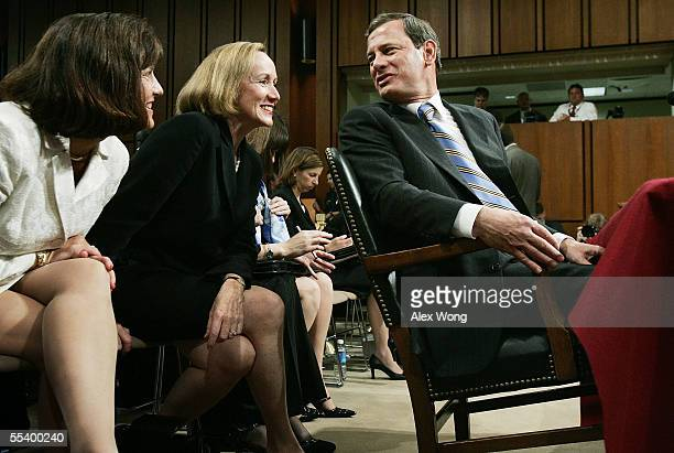 S Supreme Court Chief Justice Nominee John Roberts leans back in his chair to speak with his wife Jane Sullivan Roberts during a break on his third...