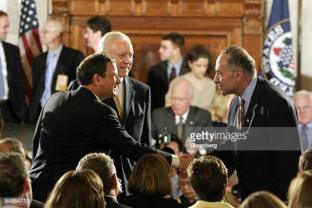 Supreme Court Chief Justice nominee John Roberts, left, shakes hands with Senator Charles Schumer prior to his testimony before the Senate Judiciary...