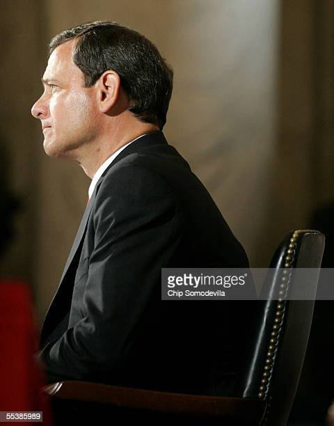 S Supreme Court Chief Justice nominee John Roberts listens to opening statements by various Senators on his first day of confirmation hearings...