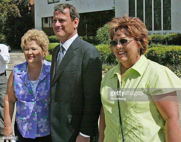 Supreme Court Chief Justice nominee John Roberts poses with tourists Jackie Adams left from Dickinson Texas and Betty Cheek from Santa Fe Texas as he...