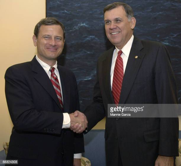 S Supreme Court Chief Justice nominee John Roberts shakes hands with Senator Mel Martinez in his Senate office on Capitol Hill September 9 2005 in...
