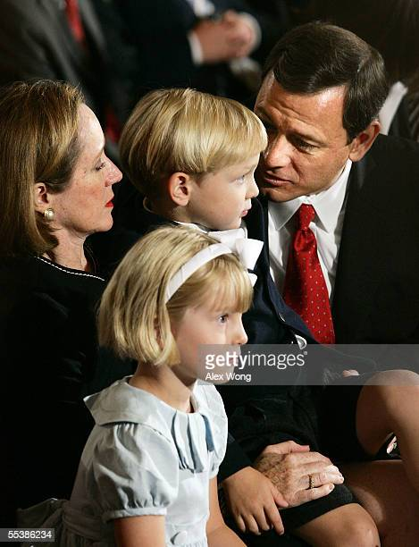 S Supreme Court Chief Justice nominee John Roberts speaks with his son Jack age 4 as his daughter Josie age 5 and wife Jane look on September 12 2005...