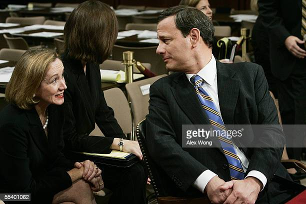 Supreme Court Chief Justice Nominee John Roberts turns to speak with his wife Jane Sullivan Roberts during a break on his third day of confirmation...