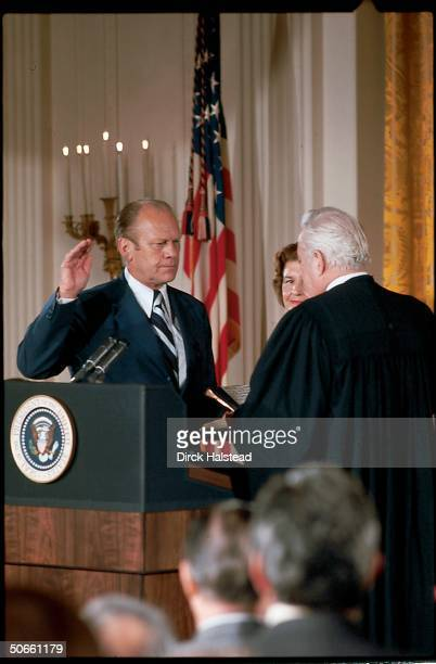 Supreme Court Chief Justice Warren Burger swearing in former VP Gerald Ford as the nation's 38th President the same day as former President Richard...