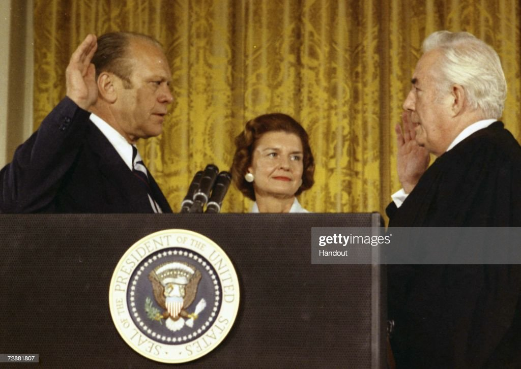 Supreme Court Chief Justice Warren Burger (R) swears in President Gerald Ford August 9, 1974 in Washingon, DC. The former President passed away at his home in California December 26, 2006. He was 93.